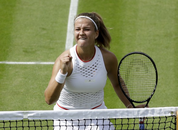 Czech Republic's Karolina Muchova celebrates winning a point against Czech Republic's Karolina Pliskova in a women's singles match during day seven of the Wimbledon Tennis Championships in London, Monday, July 8, 2019. (AP Photo/Ben Curtis)