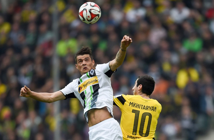 epa04700118 Dortmund's Henrikh Mkhitaryan (R) and Moenchengladbach's Granit Xhaka in action during the German Bundesliga soccer match between Borussia Moenchengladbach and Borussia Dortmund at the Borussia-Park in Moenchengladbach, Germany, 11 April 2015.  EPA/MAJA HITIJ (EMBARGO CONDITIONS - ATTENTION: Due to the accreditation guidelines, the DFL only permits the publication and utilisation of up to 15 pictures per match on the internet and in online media during the match.)