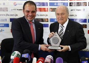 epa04547935 (FILE) FIFA Vice-President representing Asia, Prince Ali Bin al Hussein (L) presents a souvenir to FIFA President, Sepp Blatter (R) during a press conference in Amman, Jordan, 26 May 2014.  FIFA's current vice president Prince Ali bin al-Hussain said on 06 January 2015 he planned to challenge the incumbent Sepp Blatter for the presidency. The determination by Swiss national Blatter to run for a fifth consecutive term has met with criticism across Europe. Al-Hussain had been widely considered a favourite to challenge Blatter in the upcoming poll.  EPA/JAMAL NASRALLAH