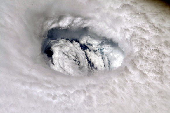 epa07814007 A handout photo made available by NASA shows an image of Hurricane Dorian's eye taken by NASA astronaut Nick Hague, from aboard the International Space Station (ISS), 02 September 2019. The station orbits more than 200 miles above the Earth. Hurricane Dorian, which made landfall on the Bahamas as category 5 and now reclassified as category 4, is expected to continue on its projected path towards the Florida coast in the upcoming days.  EPA/NASA HANDOUT  HANDOUT EDITORIAL USE ONLY/NO SALES