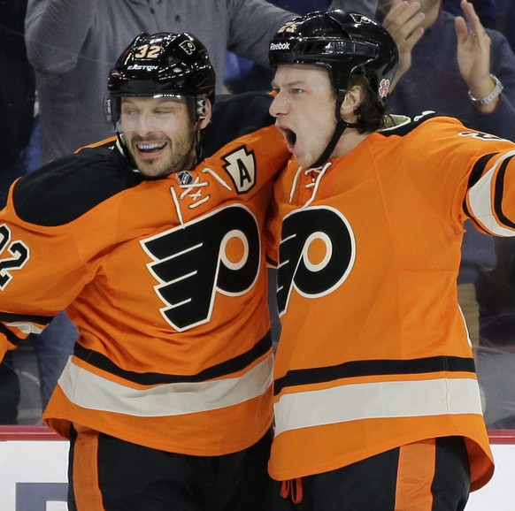 Philadelphia Flyers' Ryan White, right, and Mark Streit, of Switzerland, celebrate after White's goal during the second period of an NHL hockey game against the Nashville Predators, Saturday, Feb. 21, 2015, in Philadelphia. (AP Photo/Matt Slocum)