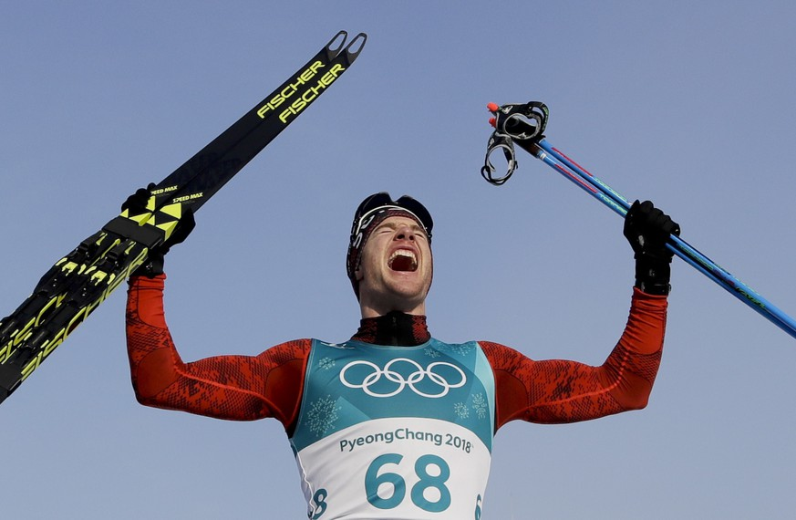 Dario Cologna, of Switzerland, celebrates after winning the gold medal in the men's 15km freestyle cross-country skiing competition at the 2018 Winter Olympics in Pyeongchang, South Korea, Friday, Feb. 16, 2018. (AP Photo/Kirsty Wigglesworth)