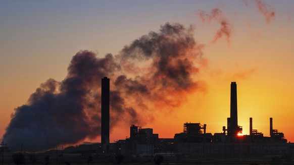 FILE - In this July 27, 2018, file photo, the Dave Johnson coal-fired power plant is silhouetted against the morning sun in Glenrock, Wyo. A record drop in U.S. energy consumption this spring was driven by less demand for coal that's burned for electricity and oil that's refined into gasoline and jet fuel. (AP Photo/J. David Ake, File)