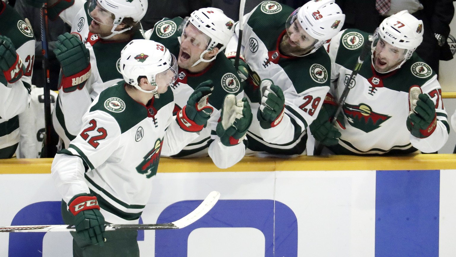 Minnesota Wild right wing Kevin Fiala (22), of Switzerland, is congratulated after scoring his second goal of the game against the Nashville Predators in the third period of an NHL hockey game Tuesday, March 5, 2019, in Nashville, Tenn. (AP Photo/Mark Humphrey)