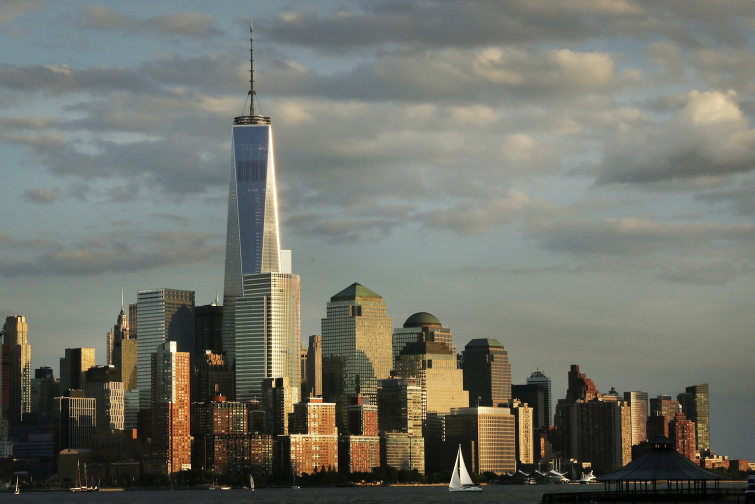 In this Sunday, Sept. 7, 2014 photo, 1 World Trade Center towers above the lower Manhattan skyline in New York. Thirteen years after 9/11 forever changed the New York skyline, officials say developments at the World Trade Center are on track and on budget. (AP Photo/Mark Lennihan)