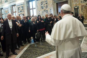 In this photo released by Vatican newspaper L'Osservatore Romano, Pope Francis meets members of the Italian pro-life movement, at the Vatican Friday, April 11, 2014. (AP Photo/L'Osservatore Romano)