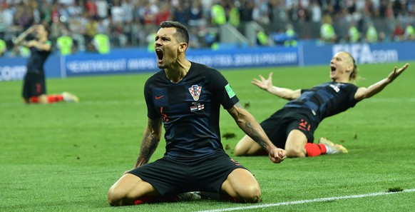 epa06882019 Dejan Lovren (C) of Croatia celebrates with teammates after winning the FIFA World Cup 2018 semi final soccer match between Croatia and England in Moscow, Russia, 11 July 2018.
