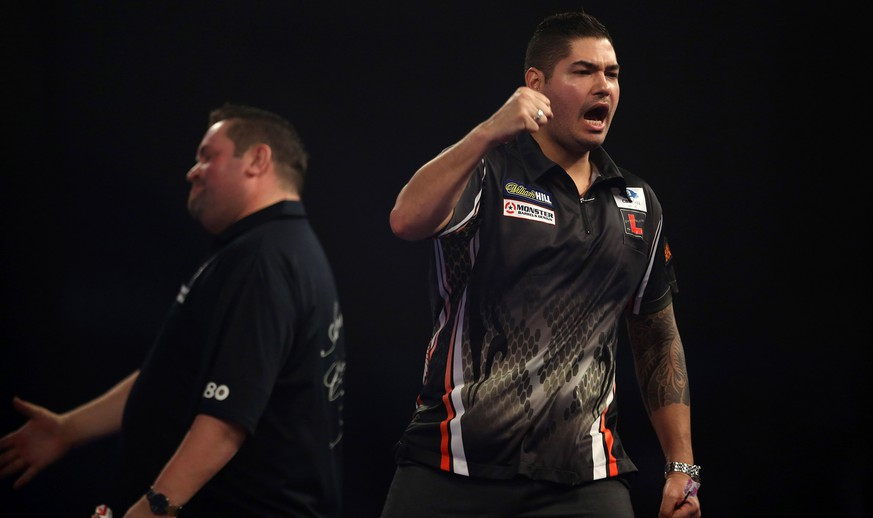 Jelle Klaasen of the Netherlands celebrates winning against England's Alan Norris in the quarterfinal of the PDC World Championship darts match in London, Friday Jan. 1, 2016. (Steve Paston/PA via AP) UNITED KINGDOM OUT NO SALES NO ARCHIVE