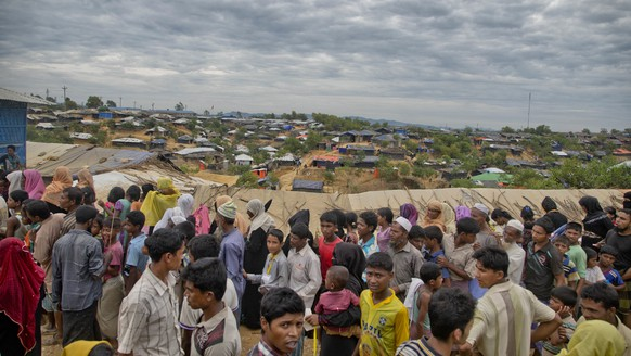Rohingya Muslims, who crossed over from Myanmar into Bangladesh, wait in queues to receive aid at Kutupalong refugee camp in Ukhiya, Bangladesh, Wednesday, Nov. 15, 2017. Secretary of State Rex Tillerson said Wednesday that the U.S. is deeply concerned by