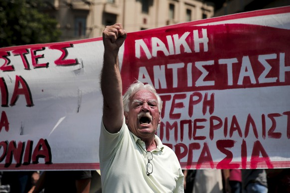 A protester shouts slogans during a rally organised by the country's biggest public sector union ADEDY marking a 24-hour strike in Athens, Greece July 15, 2015. Prime Minister Alexis Tsipras battled to win lawmakers' approval on Wednesday for a bailout deal to keep Greece in the euro and avoid bankruptcy, as the IMF pressured Greece's creditors to provide massive debt relief for its crippled economy.  REUTERS/Alkis Konstantinidis