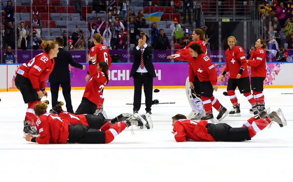 SOCHI, RUSSIA - FEBRUARY 20:  Switzerland celebrates after defeating Sweden 4-3 during the Ice Hockey Women's Bronze Medal Game on day 13 of the Sochi 2014 Winter Olympics at Bolshoy Ice Dome on February 20, 2014 in Sochi, Russia.  (Photo by Martin Rose/Getty Images)