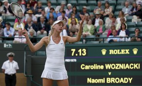 Naomi Broady of Britain reacts during her women's singles tennis match against Caroline Wozniacki of Denmark at the Wimbledon Tennis Championships, in London June 25, 2014.           REUTERS/Suzanne Plunkett (BRITAIN  - Tags: SPORT TENNIS)