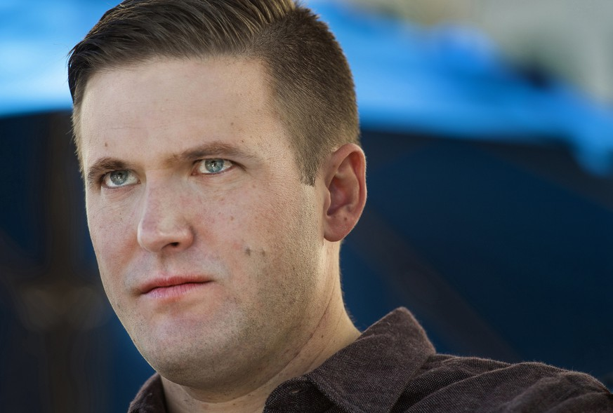 "FILE - In this Nov. 18, 2016, file photo, Richard Spencer attends a white nationalist and ""Alt-right"" conference in Washington. The exclusive Dallas boys' prep school that Spencer attended, St. Mark's School, is denouncing the activities and ideas of its white nationalist alumnus. The school's headmaster David Dini said Spencer's activities have"