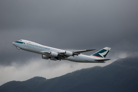 epa05492249 A Cathay Pacific cargo plane takes off from Hong Kong International Airport in Hong Kong, China,17 August  2016. Cathay Pacific's first-half net profit declined by 82.1 per cent, hurt by fewer tourist arrivals, cut backs in corporate travel and intense competition from mainland Chinese airlines. Cathay's cargo-carrying business yield fell 17.6 per cent, while the cargo traffic declined 2.3 per cent.  EPA/JEROME FAVRE
