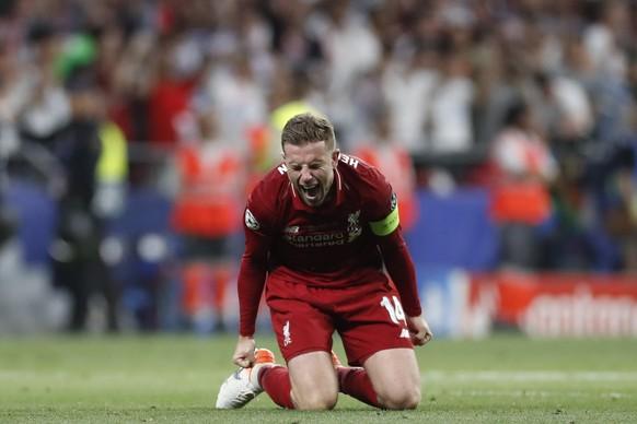 Liverpool's Jordan Henderson celebrates at the end of the Champions League final soccer match between Tottenham Hotspur and Liverpool at the Wanda Metropolitano Stadium in Madrid, Saturday, June 1, 2019. (AP Photo/Bernat Armangue)