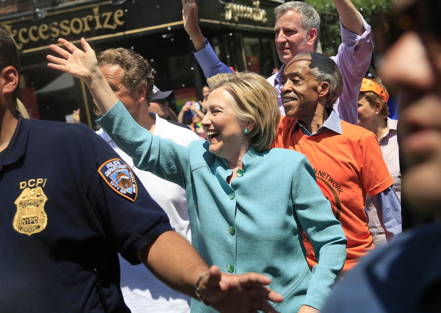 Democratic presidential candidate Hillary Clinton marches in the NYC Pride Parade in New York, Sunday, June 26, 2016. Sunday's parades in New York, San Francisco and other cities are unfolding two weeks after a gay nightclub in Florida became the site of the nation's deadliest mass shooting by a single gunman in modern U.S. history. (AP Photo/Seth Wenig)