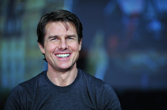 epa04285010 US actor and cast member Tom Cruise smiles during a press conference promoting his latest movie 'Edge of Tomorrow' in Tokyo, Japan, 27 June 2014. Edge of Tomorrow will be screened across Japan from 04 July. The movie is based on the science fiction novel 'All You Need Is Kill' by Japanese writer Hiroshi Sakurazaka.  EPA/FRANCK ROBICHON