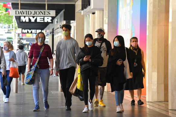 epa08779527 People walk along Bourke Street Mall outside of Myer despartment store in Melbourne, Victoria, Australia, 28 October 2020. Further coronavirus restrictions were eased in metropolitan Melbourne last night.  EPA/JAMES ROSS AUSTRALIA AND NEW ZEALAND OUT