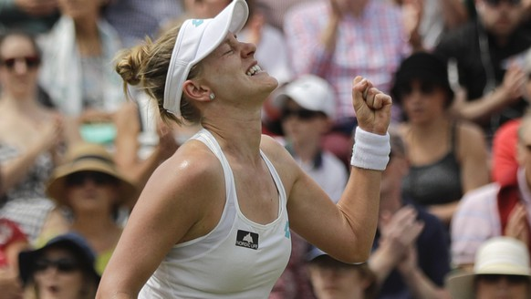 United States' Alison Riske celebrates winning a point against Australia's Ashleigh Barty in a women's singles match during day seven of the Wimbledon Tennis Championships in London, Monday, July 8, 2019. (AP Photo/Ben Curtis)