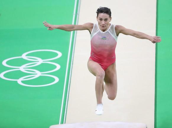 epa05462051 Oksana Chusovitina of Uzbekistan competes on the Vault during the Women's Qualification of the Rio 2016 Olympic Games Artistic Gymnastics events at the Rio Olympic Arena in Barra da Tijuca, Rio de Janeiro, Brazil, 07 August 2016.  EPA/TATYANA ZENKOVICH