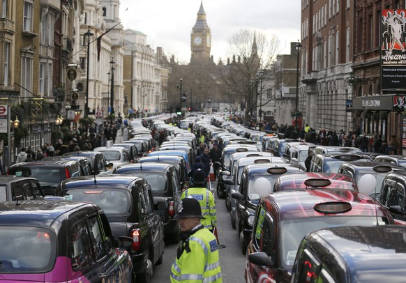FILE - In this Wednesday, Feb. 10, 2016 file photo, London taxis block the roads during a protest in central London, concerned with unfair competition from services such as Uber. London's transit operator says it is not renewing Uber's license to operate in the British capital. Uber's license expires Monday Nov. 25, 2019. (AP Photo/Frank Augstein, File)