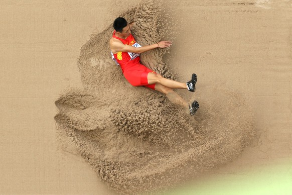 CORRECTED VERSION: BEIJING, CHINA - AUGUST 24:  Jianan Wang of China competes in the Men's Long Jump qualification during day three of the 15th IAAF World Athletics Championships Beijing 2015 at Beijing National Stadium on August 24, 2015 in Beijing, China.  (Photo by Ian Walton/Getty Images)