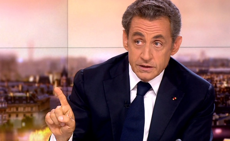 A TV grab taken from French TV channel France 2 on September 21, 2014 shows former French president Nicolas Sarkozy speaking during France 2 broadcast news in Paris.  Sarkozy, who finally ended months of speculation over his comeback on September 19, 2014 with an announcement on Facebook, will be standing for the UMP presidency in November, pledging a total reform of the party in a Sunday interview. AFP PHOTO / FRANCE 2