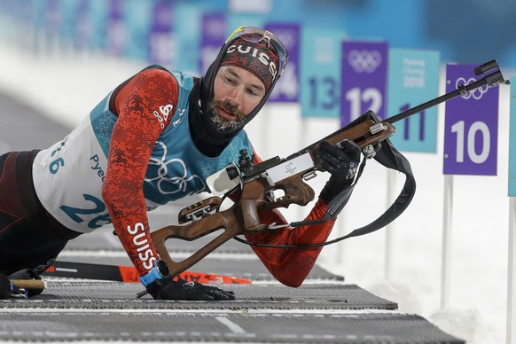Benjamin Weger, of Switzerland, gets up from the prone shooting position during the men's 10-kilometer biathlon sprint at the 2018 Winter Olympics in Pyeongchang, South Korea, Sunday, Feb. 11, 2018. (AP Photo/Andrew Medichini)
