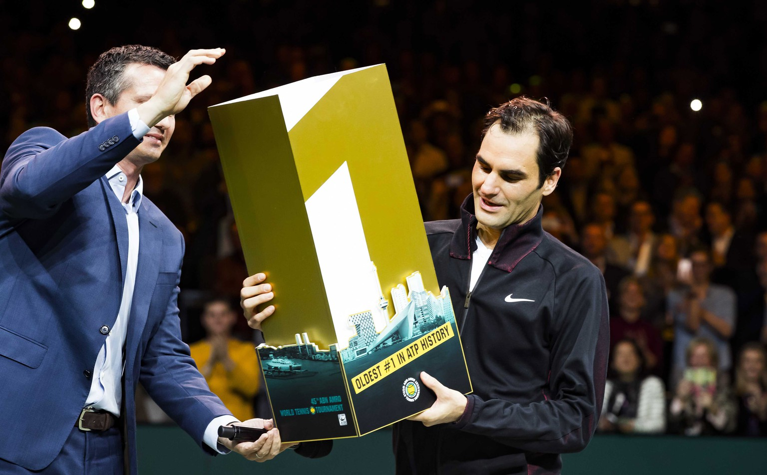 epa06533811  Roger Federer of Switzerland receives a trophy for getting the highest ranking again at the ATP after winning from  Robin Haase of the Netherlands in their quarter final match of the ABN AMRO World Tennis Tournament in Rotterdam, Netherlands, 16 February 2018.  EPA/KOEN SUYK
