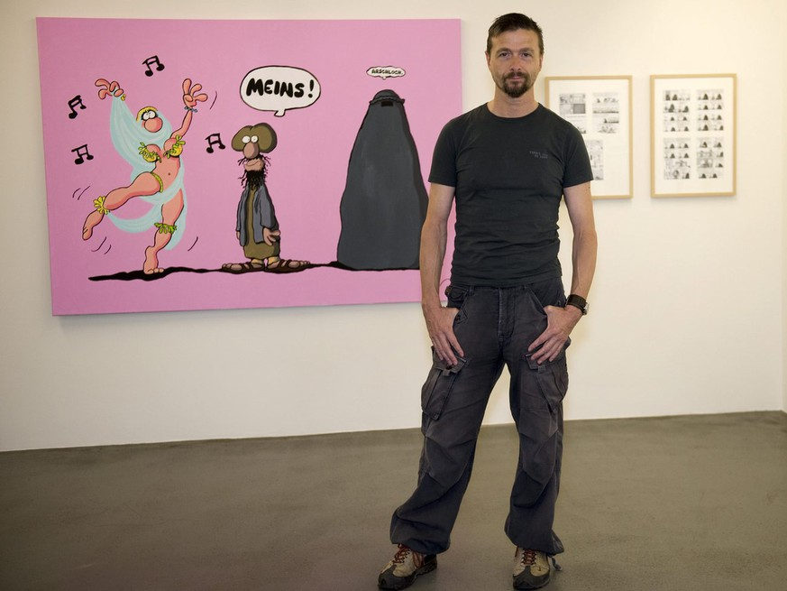 Ralf Keonig (born 1960 in Germany) poses in his exhibition in the cartoon museum in Basel, Switzerland on Thursday, June 9, 2011. The exhibition 'Gottes Werk und Koenigs Beitrag' (God's creation and Koenig's contribution) prensents a comprehensive overview of Keonig's work and lasts until October 23, 2011. (KEYSTONE/Georgios Kefalas)