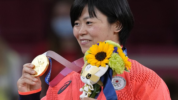 Shori Hamada of Japan celebrates with her gold medal during the awarding ceremony of the women's -78kg judo match of the 2020 Summer Olympics in Tokyo, Japan, Thursday, July 29, 2021. (AP Photo/Vincent Thian)