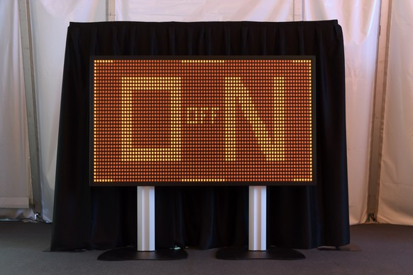 epa08082886 A screen with on and off words is displayed during the official shutdown of the Muehleberg nuclear power plant in Muehleberg, Switzerland, 20 December 2019. The Muehleberg nuclear power plant is closing after 47 years of operation. The removal of the nuclear power plant will last till 2034.  EPA/ANTHONY ANEX