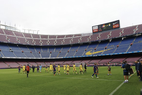 "epa06238902 Players leave the empty Camp Nou stadium after the Spanish Primera Division match between FC Barcelona and UD Las Palmas, in Barcelona, Spain, 01 October 2017. The board of the FC Barcelona decided to play behind closed doors. The club released a statement on their official website which reads: ""FC Barcelona condemns the events which have taken place in many parts of Catalonia today in order to prevent its citizens exercising their democratic right to free expression. Given the exceptional nature of events, the Board of Directors have decided that the FC Barcelona first-team game against Las Palmas will be played behind closed doors following the Professional Football League's refusal to postpone the game.""  EPA/Alejandro Garcia"