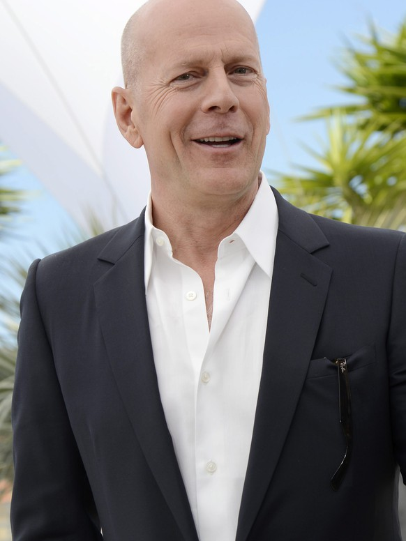 epa04659403 (FILE) A file picture dated 16 May 2012 shows US actor Bruce Willis taking pictures with his cell phone as he poses during the photocall for 'Moonrise Kingdom' at the 65th Cannes Film Festival, in Cannes, France. Bruce Willis turns 60 years of age on 19 March 2015.  EPA/STEPHANE REIX