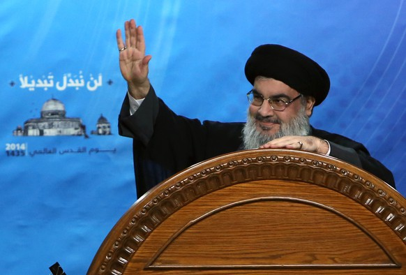 FILE - In this July 25, 2014, file photo, Hezbollah leader Sheik Hassan Nasrallah speaks during a rally to mark Jerusalem Day or Al-Quds day, in the southern suburb of Beirut, Lebanon.   On Friday, March. 27, 2015 Nasrallah ,  in a televised speech,  slammed Saudi Arabia over its military campaign in Yemen saying it is being launched under false pretexts. (AP Photo/Bilal Hussein, File)