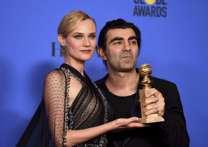 Diane Kruger, left, and Fatih Akin poses in the press room with the award for best motion picture - foreign language for