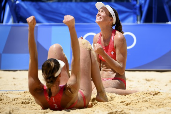 Anouk Verge-Depre, right, and Joana Heidrich, left, of Switzerland celebrate the winning after the games against Ana Patricia Silva Ramos and Rebecca Silva of Brazil during the women's beach volleyball quarterfinal match at the 2020 Tokyo Summer Olympics in Tokyo, Japan, on Tuesday, August 03, 2021. (KEYSTONE/Laurent Gillieron)