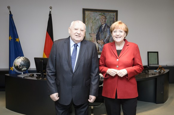 BERLIN, GERMANY - NOVEMBER 10: In this photo provided by the German Government Press Office (BPA) German Chancellor Angela Merkel (R) meets with former President of the Soviet Union Mikhail Gorbachev at the Chancellery on November 10, 2014 in in Berlin, Germany.  (Photo by Sandra Steins/Bundesregierung via Getty Images)