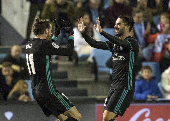"Real Madrid's Gareth Bale and teammate Francisco Román ""Isco"" celebrate after scoring the second goal against Celta during a Spanish La Liga soccer match between RC Celta and Real Madrid at the Balaidos stadium in Vigo, Spain, Sunday, Jan. 7, 2018.  (AP Photo/Lalo R. Villar)"