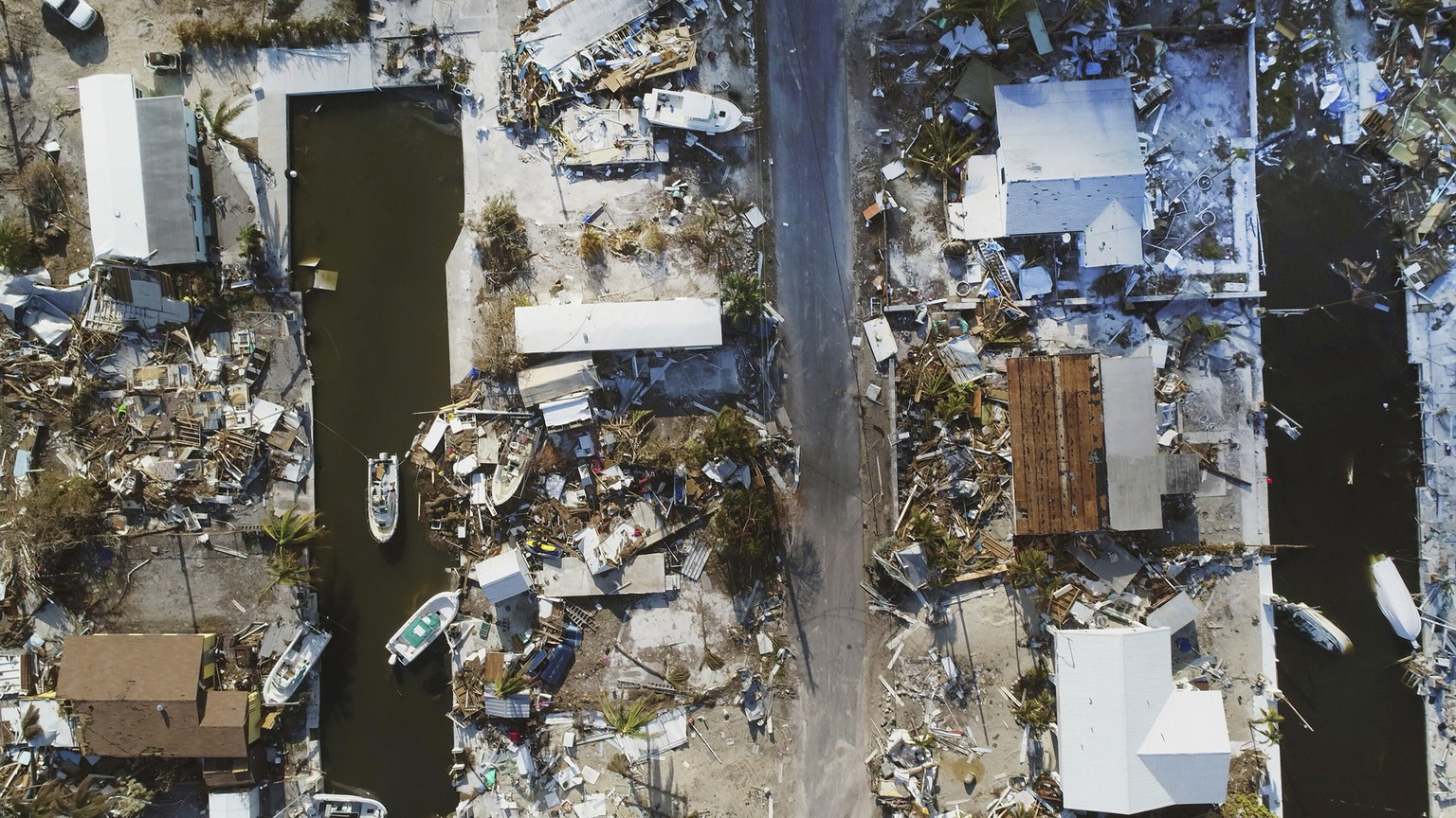 This Wednesday, Sept. 13, 2017 photo shows homes leveled by Hurricane Irma on Big Pine Key, Fla. Hurricane Irma did more than damage homes and wash out roads in the Florida Keys. The storm wiped out the dreams of many of the small entrepreneurs who populate the independent-minded islands.  (Rob O'Neal /The Key West Citizen via AP)