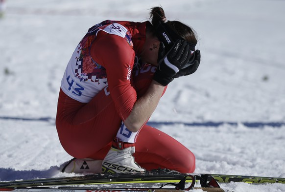 Poland's Justyna Kowalczyk bursts into tears after winning the women's 10K classical-style cross-country race at the 2014 Winter Olympics, Thursday, Feb. 13, 2014, in Krasnaya Polyana, Russia. (AP Photo/Gregorio Borgia)