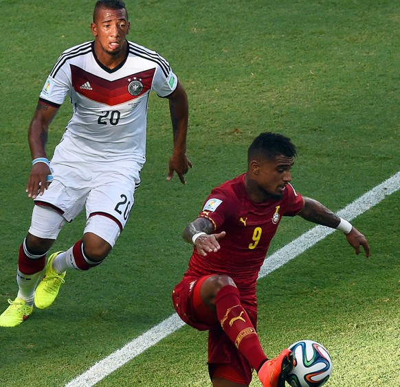 epa04271535 Kevin Prince Boateng (R) of Ghana in action against his brother Jerome Boateng (L) of Germany during the FIFA World Cup 2014 group G preliminary round match between Germany and Ghana at the Estadio Castelao in Fortaleza, Brazil, 21 June 2014. (RESTRICTIONS APPLY: Editorial Use Only, not used in association with any commercial entity - Images must not be used in any form of alert service or push service of any kind including via mobile alert services, downloads to mobile devices or MMS messaging - Images must appear as still images and must not emulate match action video footage - No alteration is made to, and no text or image is superimposed over, any published image which: (a) intentionally obscures or removes a sponsor identification image; or (b) adds or overlays the commercial identification of any third party which is not officially associated with the FIFA World Cup)  EPA/MARCUS BRANDT   EDITORIAL USE ONLY