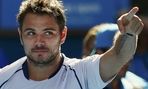 Stan Wawrinka of Switzerland celebrates defeating Kei Nishikori of Japan to win their men's singles quarter-final match at the Australian Open 2015 tennis tournament in Melbourne January 28, 2015.       REUTERS/Issei Kato (AUSTRALIA  - Tags: SPORT TENNIS)