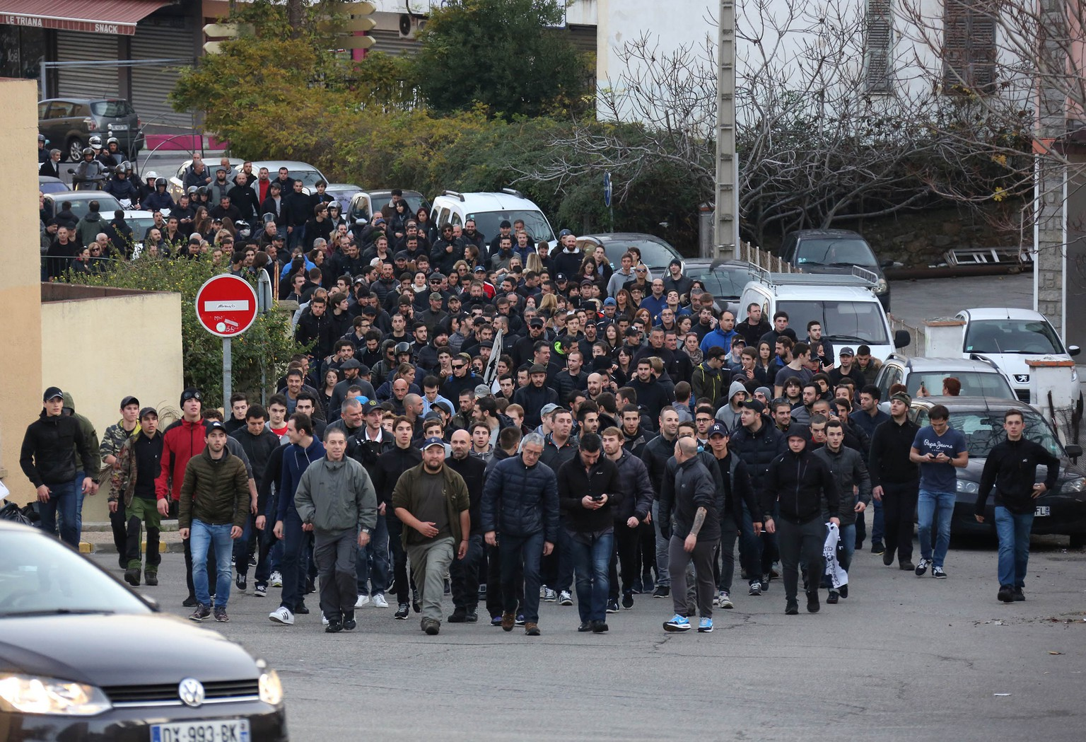 Demonstrators, most of them angry against Muslim residents, march in Ajaccio, on the French Mediterranean island of Corsica, Saturday, Dec. 26, 2015.  A crowd vandalized a Muslim prayer room in Corsica a day after an ambush left firefighters injured on the French island. (AP Photo/Jean-Pierre Belzit)