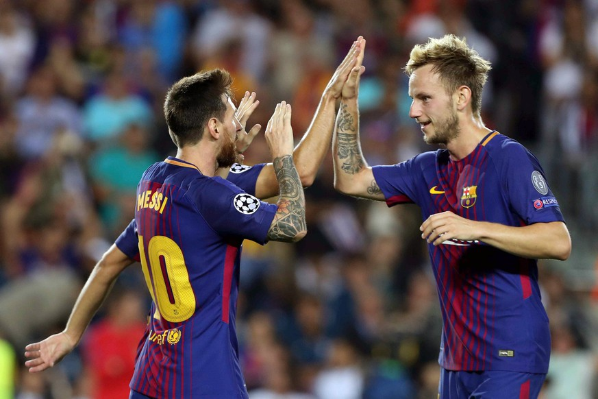 epa06200964 FC Barcelona's Lionel Messi (L) celebrates with teammate Ivan Rakitic after scoring a goal during the UEFA Champions League match between FC Barcelona and Juventus FC, in Barcelona, Catalonia, Spain, 12 September 2017.  EPA/TONI ALBIR