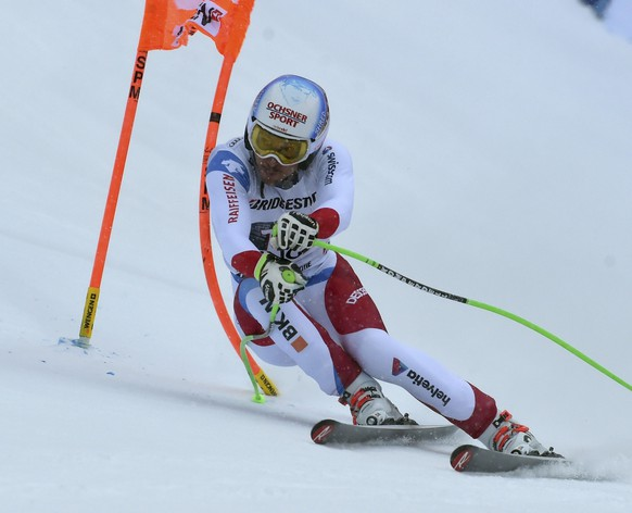 Switzerland's Carlo Janka competes during the second run of an alpine ski, men's World Cup combined race, in Wengen, Switzerland, Friday, Jan. 13, 2017. (AP Photo/Marco Tacca)