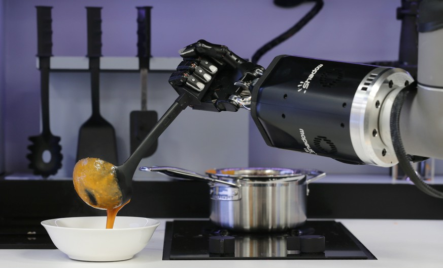 A robot in the Robotic Kitchen prototype created by Moley Robotics cooks a crab  soup at the company's booth at the world's largest industrial technology fair, the Hannover Messe, in Hanover April 13, 2015.       REUTERS/Wolfgang Rattay   TPX IMAGES OF THE DAY