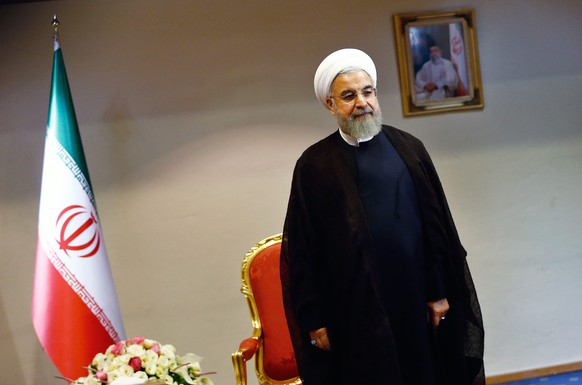 epa04828238 Iranian President, Hassan Rowhani, waits to start his meeting with the International Atomic Energy Agency (IAEA) chief, Yukiya Amano (not pictured), in Tehran, Iran, 02 July 2015. Media reported that Amano is in Tehran to discuss a probe of alleged nuclear weapons research that is a key part of Iran's planned deal between Iran and the P5+1.  EPA/ABEDIN TAHERKENAREH