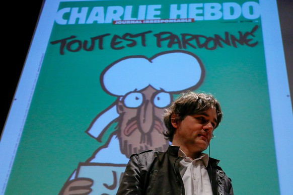 epa04831387 'Charlie Hebdo' magazine publishing director Laurent Sourisseau 'Riss', gives a conference titled 'Charlie Hebdo: how to keep humor after the massacre' during the the 10th Investigative Journalism International Congress, in Sao Paulo, Brazil, on 04 July 2015.  EPA/Carlos Villalba R