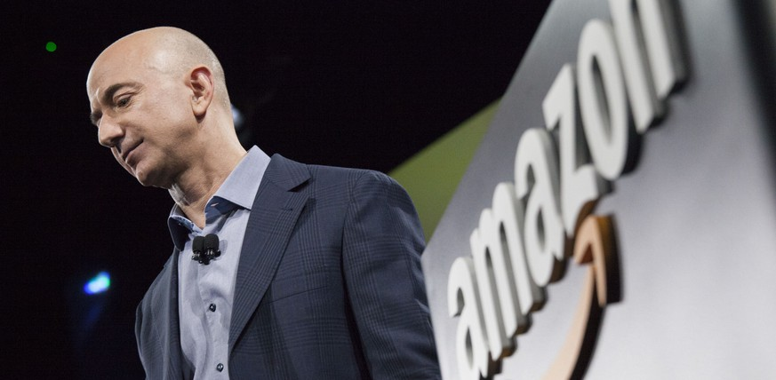 SEATTLE, WA - JUNE 18: Amazon.com founder and CEO Jeff Bezos presents the company's first smartphone, the Fire Phone, on June 18, 2014 in Seattle, Washington. The much-anticipated device is available for pre-order today and is available exclusively with AT&T service.   David Ryder/Getty Images/AFP == FOR NEWSPAPERS, INTERNET, TELCOS & TELEVISION USE ONLY ==